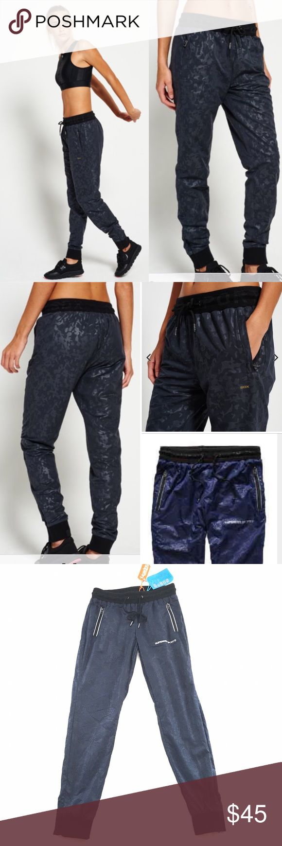 Superdry Joggers Superdry Sport gym woven jogger in 'rich navy python' print. Size M, zip pockets and zip ankles. Elastic waistband and drawstring. NWT Superdry Pants Track Pants & Joggers