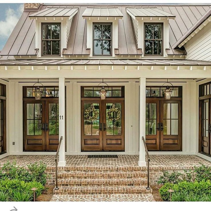 """http://www.houzz.com/projects/1811048/palmetto-bluff-south-carolina-low-country-home Brick is """"Walnut Creek"""" by statesville brick, siding is SW7009 """"Pearly White"""" by Sherwin Williams, and roofing is standing seam dark bronze."""