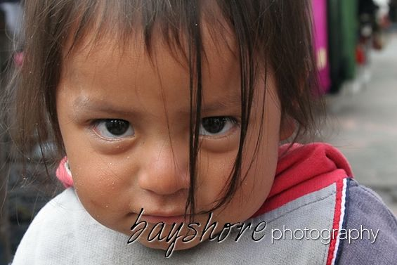 This young girl at a market in Ecuador had the most amazing eyes. by Bayshore Photography @bayshorephoto
