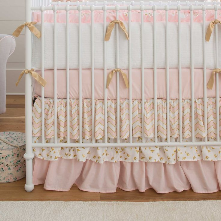 Carousel Designs: Pale Pink and Gold Chevron Crib Bedding Girly and feminine with a splash of glitz. This beautiful pale pink shade has just a hint of peach creating a soft and soothing feeling. The sparkling gold accents glam it up to the perfect level for your favorite little princess's nursery.