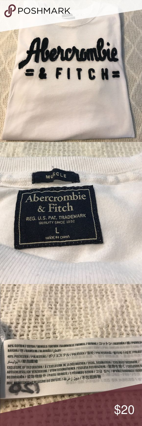 """Men's Abercrombie & Fitch White Blue Muscle Shirt Abercrombie & Fitch White & Blue Muscle T-shirt. Gently-used. Piling throughout but so minimal camera cannot pick up. Great quality! Stretchy material. Measurements all approximate: 19"""" armpit to armpit; 30"""" top of shoulder to Bottom Abercrombie & Fitch Shirts"""