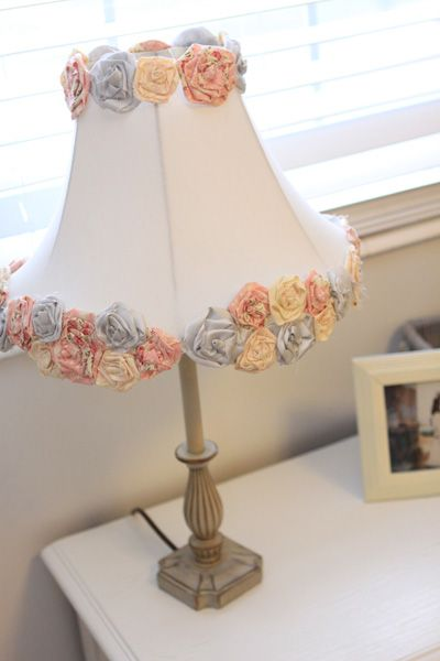 Simple DIY project : plain Jane lamp shade turned into an adorable shabby chic masterpiece with a few added rosettes!