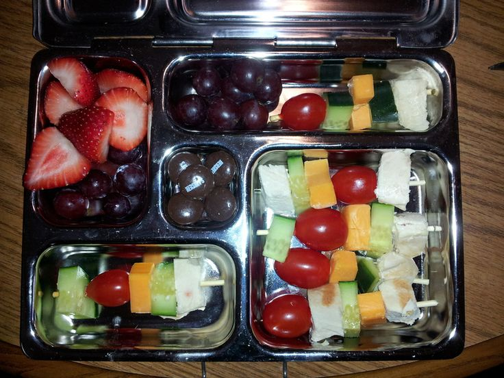 Easy shish-kabobs -- Grilled chicken breast chunks, grape tomatoes, cucumber slices, cheddar cheese chunks, strawberries, red grapes and Hershey chocolate drops.  Funny how it's way cooler when you put it on a skewer.  I used chicken shears to cut the skewers into smaller pieces so they would fit.