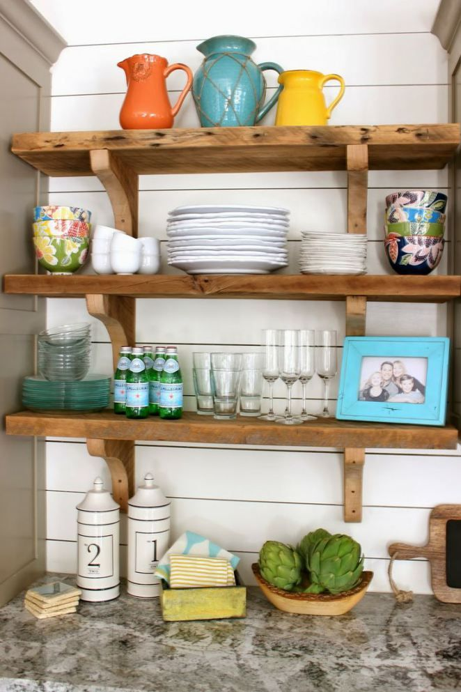 Love these colors together --the orange, turquoise, and yellow on open shelves.