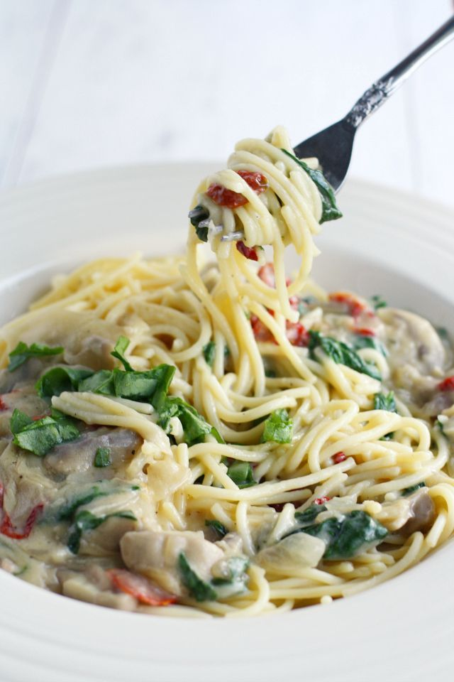 Sundried tomato, mushroom, and spinach in a cream sauce over pasta. Delicious and comforting!