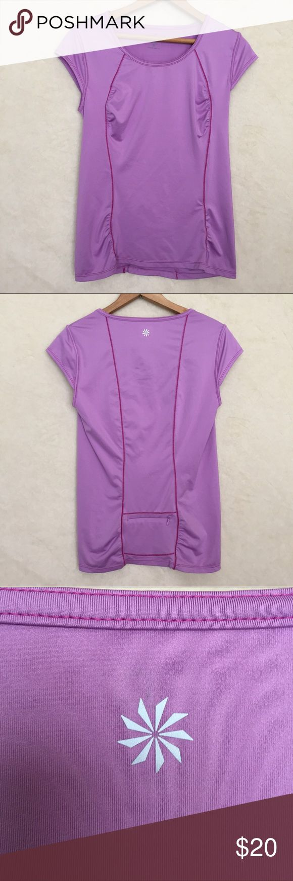 Athleta work out t-shirt sz s Athleta work out purple tee shirt with zippered pocket on back of shirt . Sz S Athleta Tops Tees - Short Sleeve