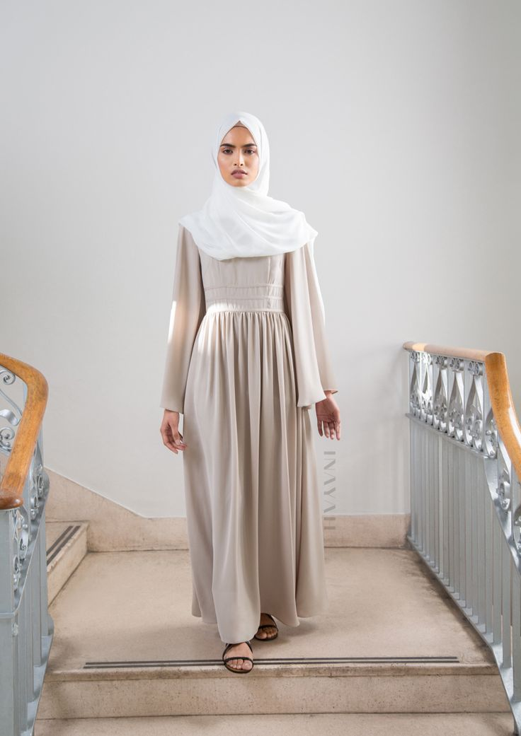 Designed with a flared cut for a relaxed fitting. Style with accessories for an everyday chic look. Stone Maxi #Dress with Binding Detail Off White Maxi Georgette #Hijab - www.inayah.co