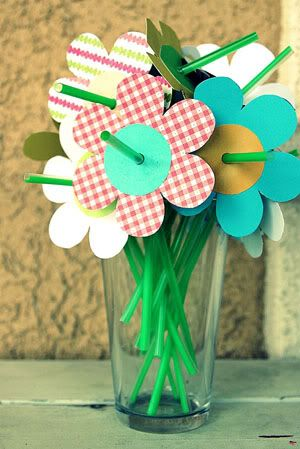 What a cool idea for straws!!!!!  Cute for summer drinks   These flowers could also be paper poinsettias that could be snipped with scissors and used as wine charms.