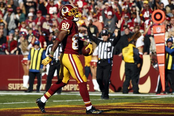 Jamison Crowder Photos Photos - Wide receiver Jamison Crowder #80 of the Washington Redskins scores a first quarter touchdown during a game against the New Orleans Saints at FedExField on November 15, 2015 in Landover, Maryland. - New Orleans Saints v Washington Redskins