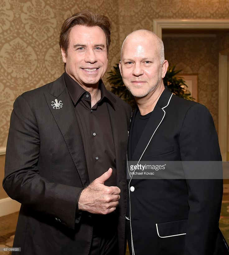 Actor John Travolta (L) and writer/director Ryan Murphy attend the 17th annual AFI Awards at Four Seasons Los Angeles at Beverly Hills on January 6, 2017 in Los Angeles, California.