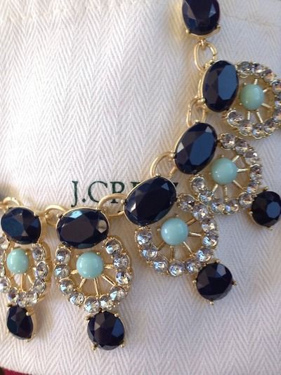 J. Crew originated the new trend of over the top statement necklaces. Everyone is copying with fake plastic gems these days.