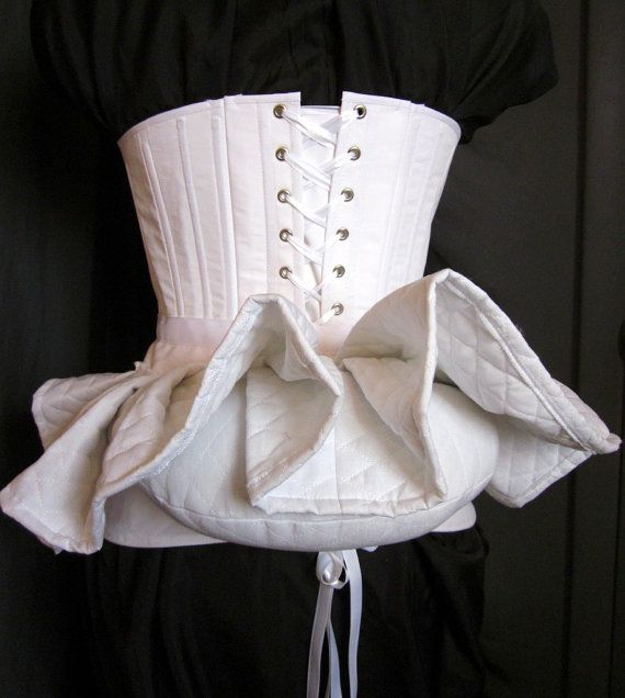 This bustle pillow creates the shelf-like silhouette of the late 1800s, holding your skirts and petticoats out in a historical moderate bustle shape.