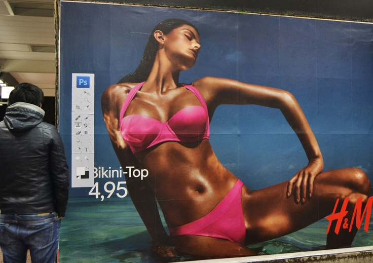 A German street artist does some culture jamming on ads to show that beauty isn't just skin deep, it's also made on computers.