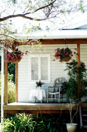 I've always fantasised about a weatherboard house with window shutters...