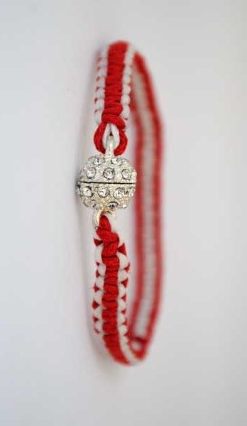 The greek March bracelet. We wear this on the 1st of March to prevent getting burned by the Sun. This custom has its roots in ancient times, where the mysts of Elefsinian mysteries would put a red/white string bracelet around their right wrist and left ankle. The custom today is common to many nations of the Balkans