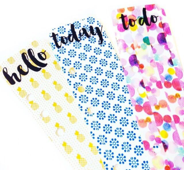 DIY Washi Page Marker Step One – Page Marker Take your card and measure 2.5 inch wides 9 inches long (A5/Large planner). Trim this down to size. Wrap washi around the card vertically or horizontally. Position-place the page marker underneath an existing page in you planner use the existing holes in your page as a guide and mark in the centre where you want to punch, use your scissors to make slits where the holes are to allow the marker to snap in and out without opening your rings…