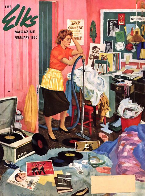 50's housewife with vacuum cleaner