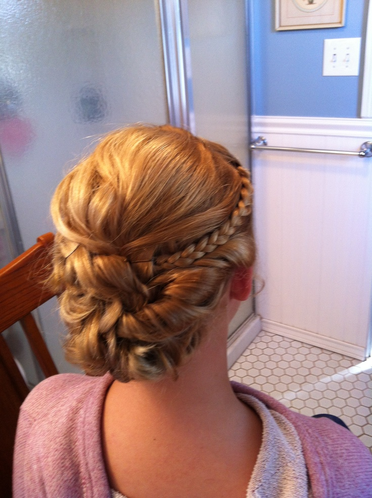 a simple small braid can add a whole new look to a bun #homecoming #hair #homecominghair