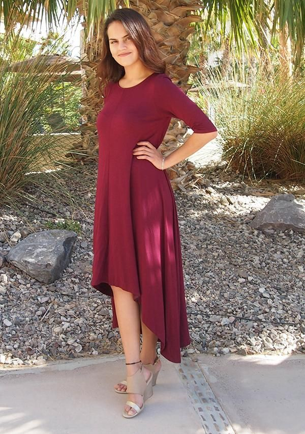 Feel like you are walking on air in our Swept Away Burgundy Red High-Low Maxi Dress. Super soft and stretchy jersey knit shapes a rounded neckline, relaxed fit bodice, three quarter long sleeves, and flowy hi low maxi skirt. Halter maxi dresses, short sleeve maxi dresses, off the shoulder maxi dresses, there is a maxi dress for everyone and every style of Maxi Dresses has it's perks! #burgundymaxidress