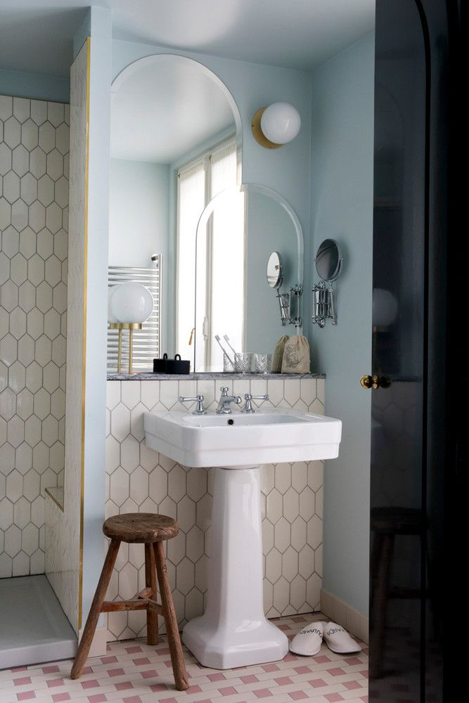 rustic accents soften a cool tilde bathroom in this chic Paris hotel