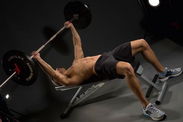 The first day of the beast workout is an upper-body day, focusing on a bench presses and a barbell complex