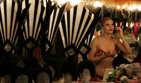Svetlana Failla put on her makeup in the dressing room of ''Les Folies Bergere'' at the Tropicana Hotel in Las Vegas last week. Below, dancers performed ''The Fans.'' After nearly 50 years, the show will have its final performance on Saturday.