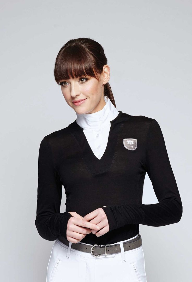 The Delta Merino Sweater is a unique hybrid that creates a single layer silhouette that instantly elevates any equestrian look. Available from Noel Asmar in Black, Twilight, and Charcoal.