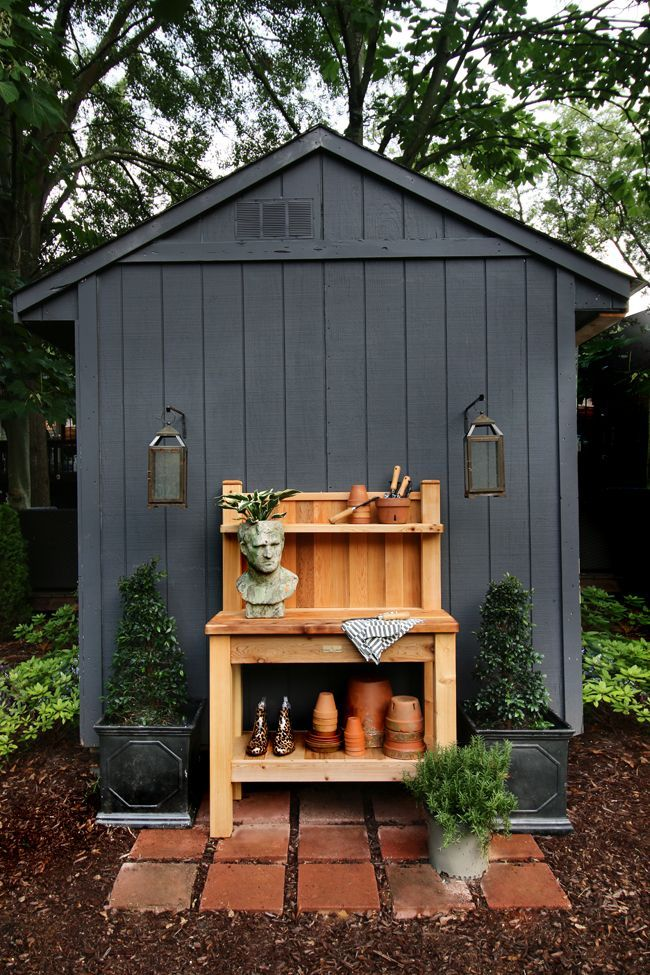 Potting Bench against Black Shed // Love the lanterns as sconces