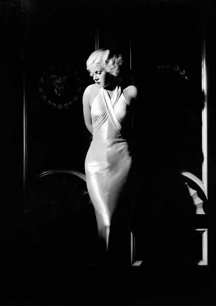 Jean Harlow wears a bias cut gown by Adrian in this 1933 photo by George Hurrell