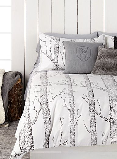 "Designed in our studios exclusively for Simons Maison     Very trendy rustic pattern with tall birch tree trunks printed in contrasting charcoal on a cream background.      The set includes:   Twin: 1 duvet cover 66"" x 90"", 1 pillow sham 20"" x 26""  Double: 1 duvet cover 84"" x 90"", 2 pillow shams 20"" x 26""  Queen: 1 duvet cover 90"" x 95"", 2 pillow shams 20"" x 30""  King: 1 duvet cover 108"" x 95"", 2 pillow shams 20"" x 36"""