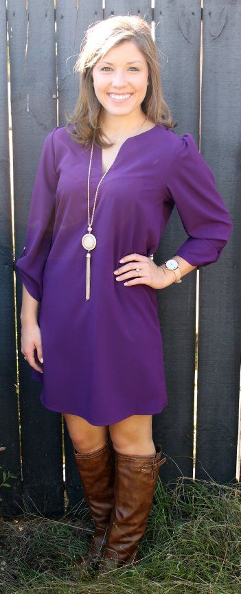 Plum colored shift dress with tan boots and a long statement necklace, cute!