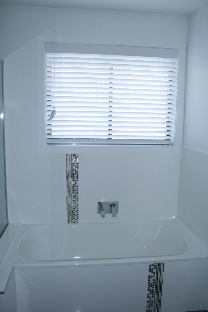 White 'eco' venetians are great for wet areas. Moisture is no problem and the window can be left open for ventilation.