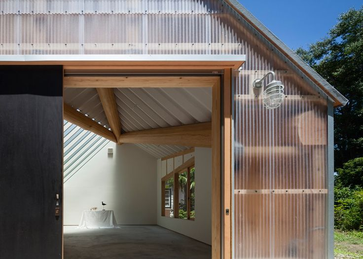 Photography studio featuring corrugated plastic walls and a faceted roof  BARNS  GARAGES