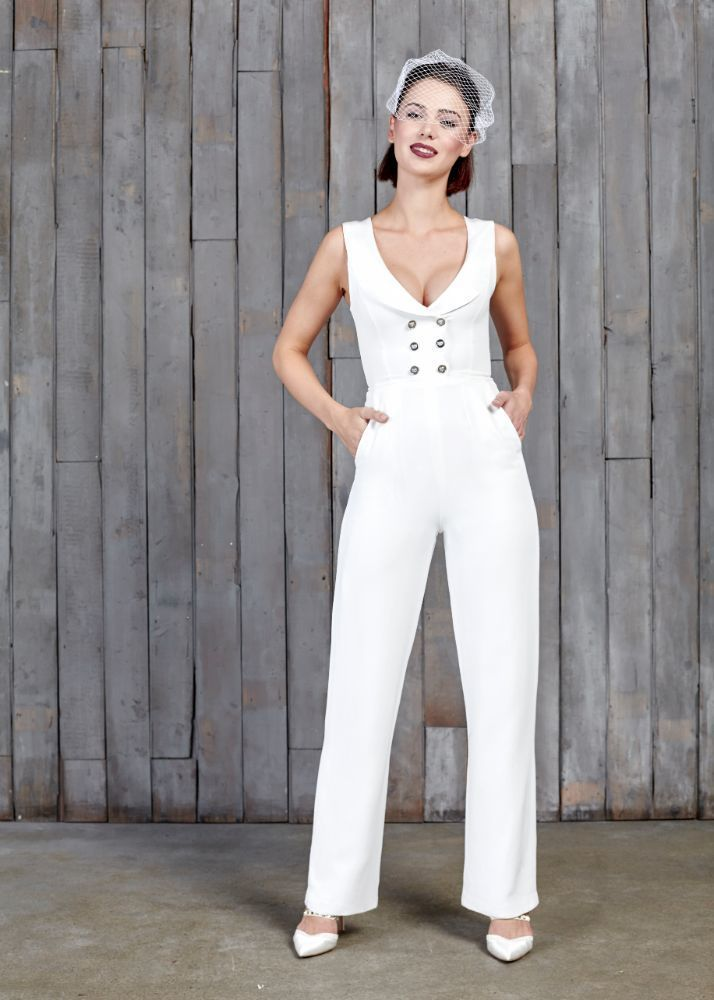 A modern day bridal jumpsuit for the modern day bride. A waistcoat designed bodice with wide legs, cool pockets, soft neckline and a touch of sheen on the lapel. Shop now at House of Ollichon. #fairgroundwedding #alternativeweddingdress #bridaljumpsuit #bridalwear #jumpsuit #twopiece