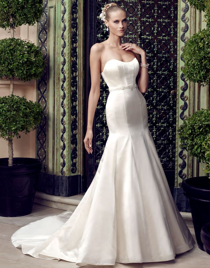 Casablanca 2187 Strapless Duchess Satin Trumpet Silhouette Gown Has Modified Sweetheart Front And Back Necklines The Of A Pleated Panel