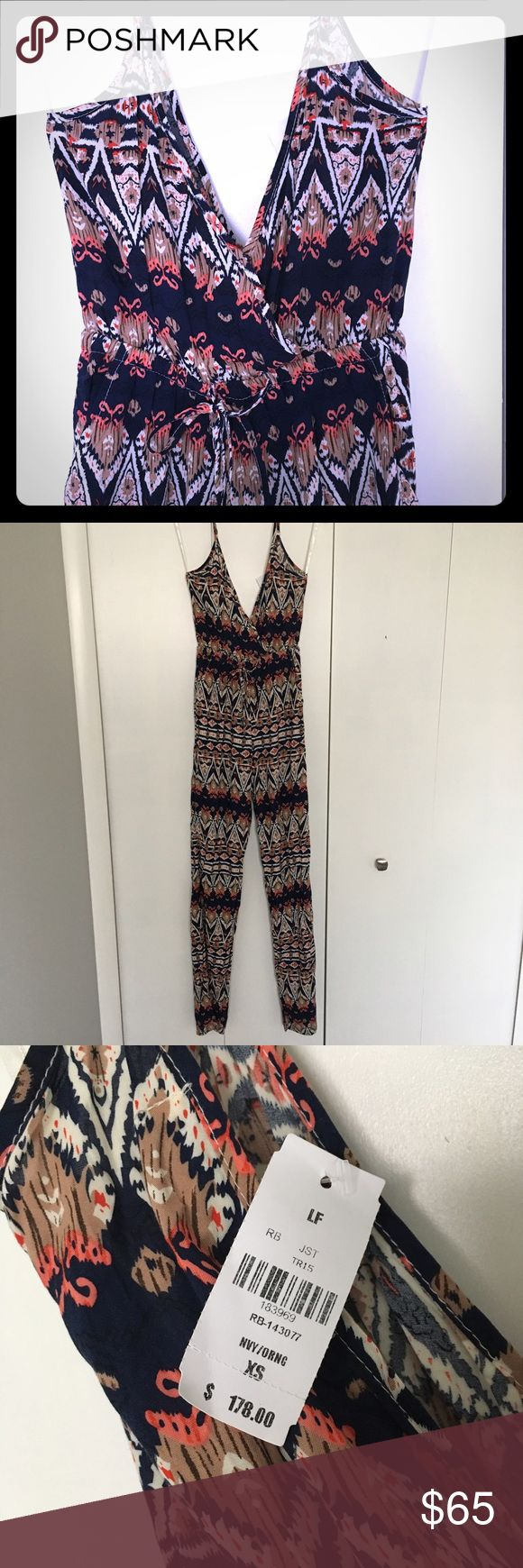 NWT LF Festival Jumpsuit Adorable Aztec patterned jumpsuit with low V-neck and front and back. Elastic at the ankles. New with tags! LF Dresses