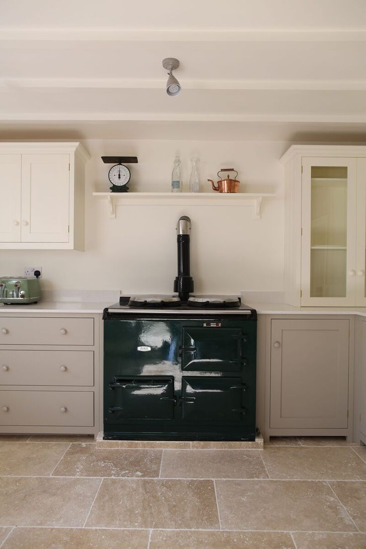 our light tumbled travertine looks great against that rich green aga and mushroom shaker kitchen - Travertine Hotel 2015