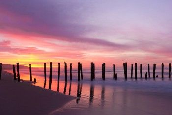 Dawn over the St Clair Poles at St Clair Beach, Dunedin, New Zealand.