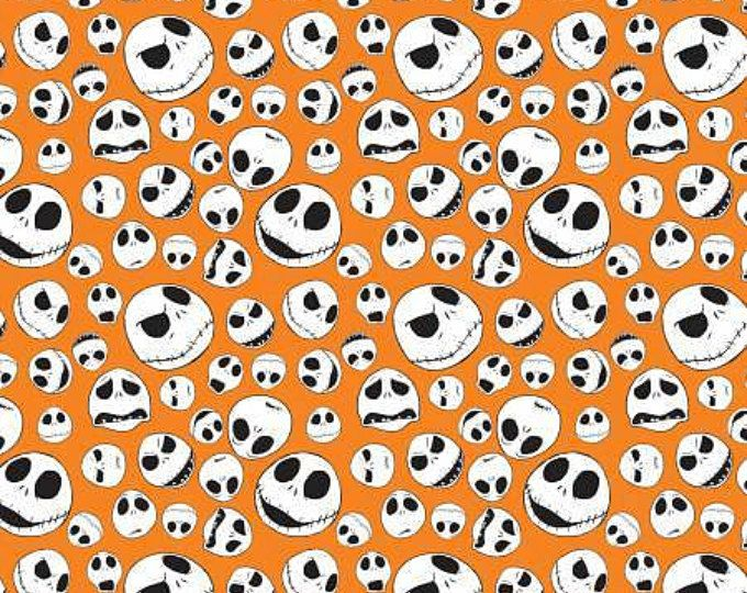 Nightmare Before Christmas Jack Faces on Orange cotton fabric by Camelot Fabrics