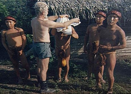 Disease and death have plagued indigenous communities in South America since they first came into contact with outsiders from Europe in the 1500s. The indigenous populations had no immune protection against smallpox, measles, and flu, which wiped out thousands of communities. By 1984, when this photograph was taken of Indians who appeared from the forest one day at an oil exploration camp in eastern Peru, only a few isolated uncontacted communities survived. Today, the last remnants of indige...: Marginalized Peoples, Indian, Forest, Exploration Camp
