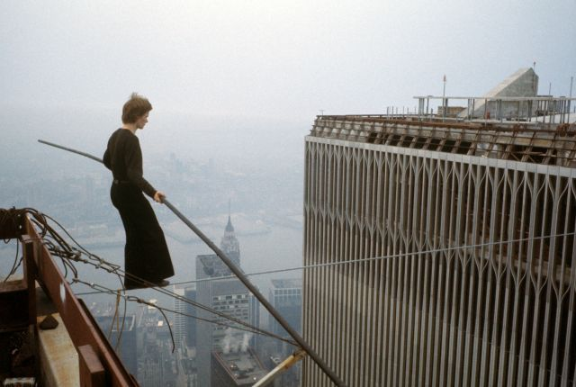 Philippe Petit walking the wire suspended between the twin towers of the not-yet-completed World Trade Center on August 7 1974.