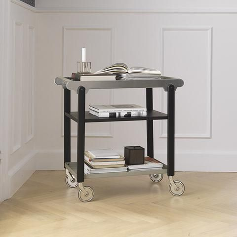 The multifunctional drink trolley/bar cart can be easily moved around using its graceful wheels and the upper tray can be removed to become a serving tray. Use Anoon as a supplementary table or shelving unit in the kitchen, dining room, hallway or home bar.