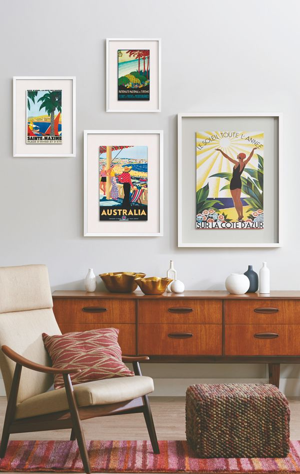 Design a worldly gallery wall with vintage-inspired travel art. I enjoy the look of this spot --