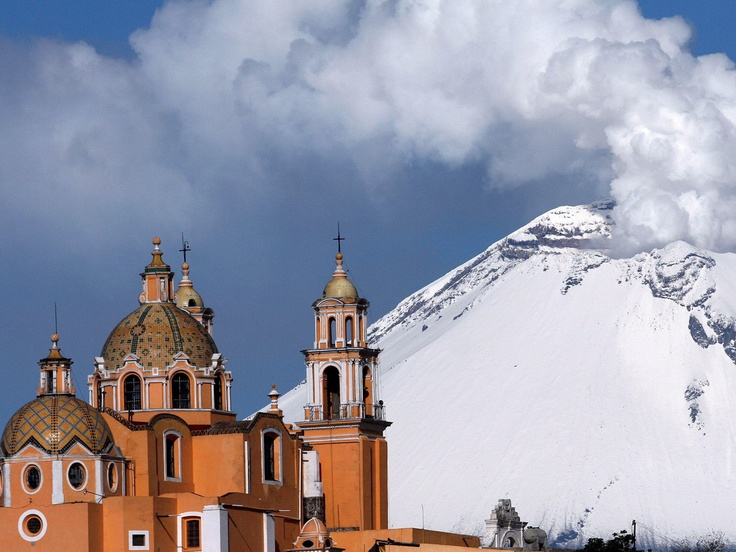 Popocatepetl Volcano, Puebla, Mexico.  Additionally, Puebla is where  Talavera tile/pottery  has it's roots, and, in fact the  cupola/roofs of this  church (Nuestra Senora  de  Valvanera) is  decorated in talavera tiles