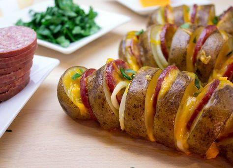 Looking to add some excitement to your boring old baked potato?Try this Roasted Potato & Summer Sausage Fans recipe! All Spruce up those potatoes with summer sausage, cheddar cheese, onions, and olive oil! Cooking out on the grill? Wrap them in foil & throw them on the barbeque! - Johnsonville.com
