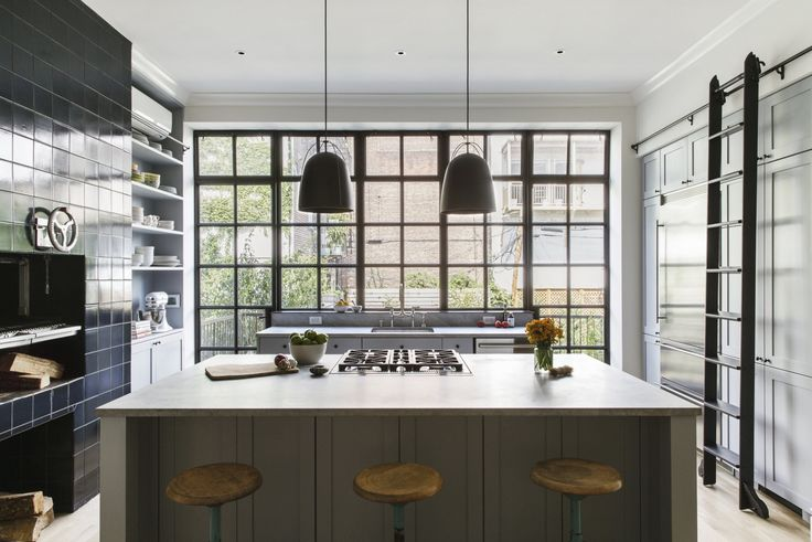 In a Brooklyn kitchen, Elizabeth Roberts added a wall of cabinetry accessed via a rolling ladder from Rolling Ladders. For more, go to Brooklyn Revival: A Bright and Open Family House.Photograph byDustin Aksland, courtesy of Elizabeth Roberts.