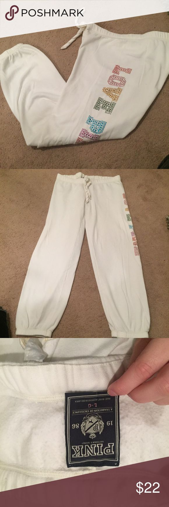 PINK Victoria's Secret - jogger sweatpants PINK Victoria's Secret - jogger sweatpants, size large. white- no discoloration great used condition. multi color rhinestone lettering along outside leg. PINK Victoria's Secret Pants Track Pants & Joggers