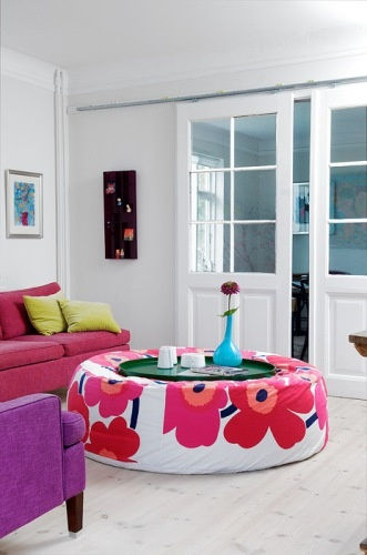 Love this Marrimekko fabric coffee table....good baby-friendly padding!