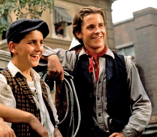 Christian Bale, Newsies Long before he was Batman, Bale showed off his singing chops as Jack Kelly in the 1992 movie musical, Newsies.