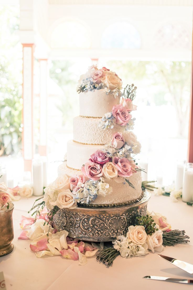 chic wedding with a lush floral wall backdrop classic wedding cakespretty